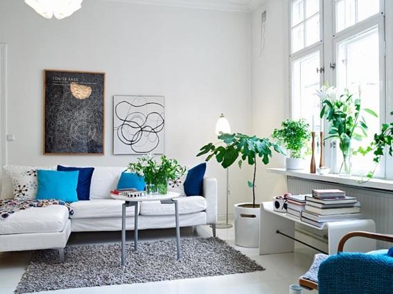 Salas decoradas con plantas for Decoracion paredes sala