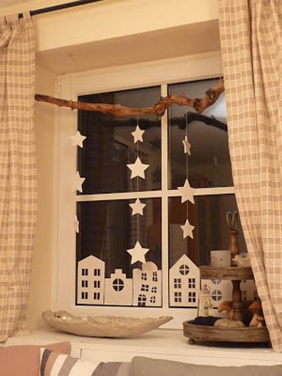 Decoracion Ventanas Navidad ~ Siluetas de papel en forma de casas y estrellas son una gran idea